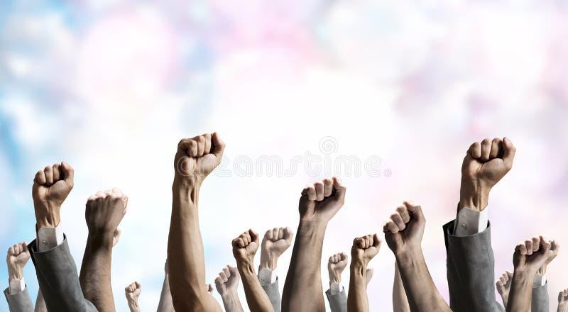 De handen rised omhoog stock afbeelding