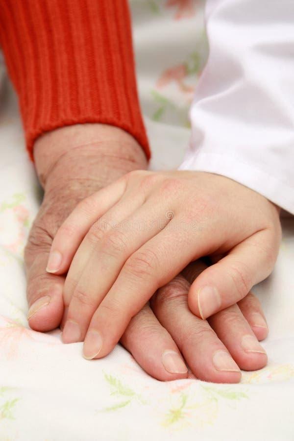 De Handen van de holding stock foto