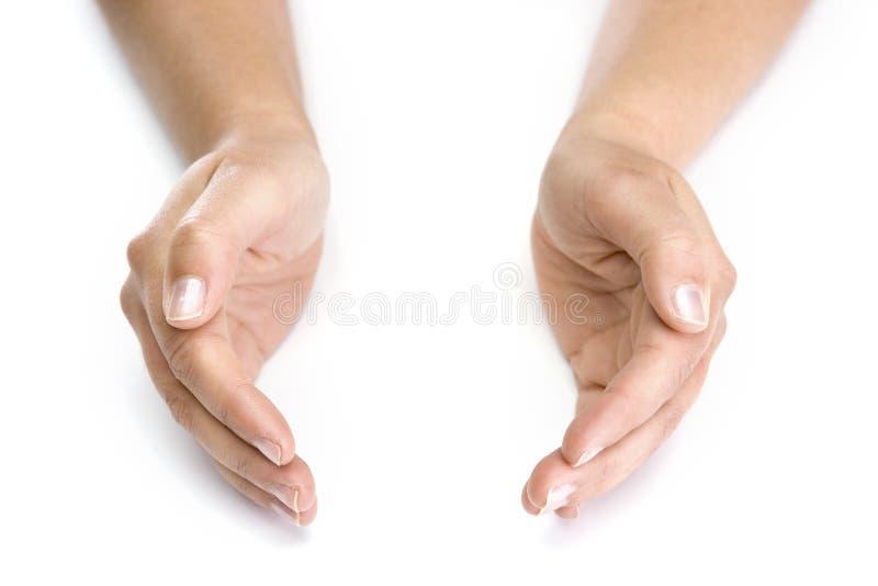 De handen van de vrouw die op witte achtergrond worden geïsoleerdd royalty-vrije stock afbeelding