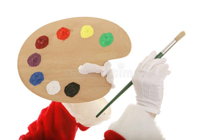 De Handen van Santas met het Palet van de Kunstenaar royalty-vrije stock afbeeldingen