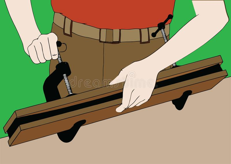 De handen van de timmerman haalt klemmen op twee assen aan royalty-vrije illustratie
