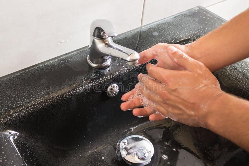 De handen van de was met zeep Concept - hygiëne, goede gewoonten, water royalty-vrije stock foto