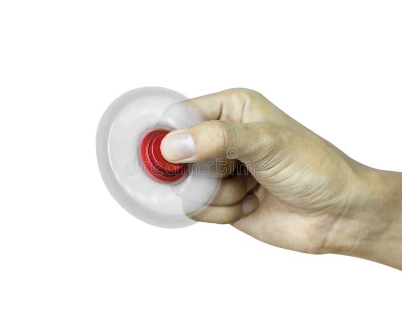 De handholding friemelt spinner op witte achtergrond wordt geïsoleerd die Spannings verlichtend stuk speelgoed royalty-vrije stock foto's