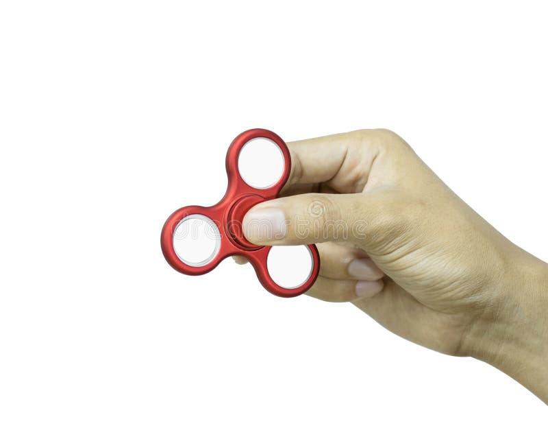 De handholding friemelt spinner op witte achtergrond wordt ge?soleerd die Spannings verlichtend stuk speelgoed stock afbeelding