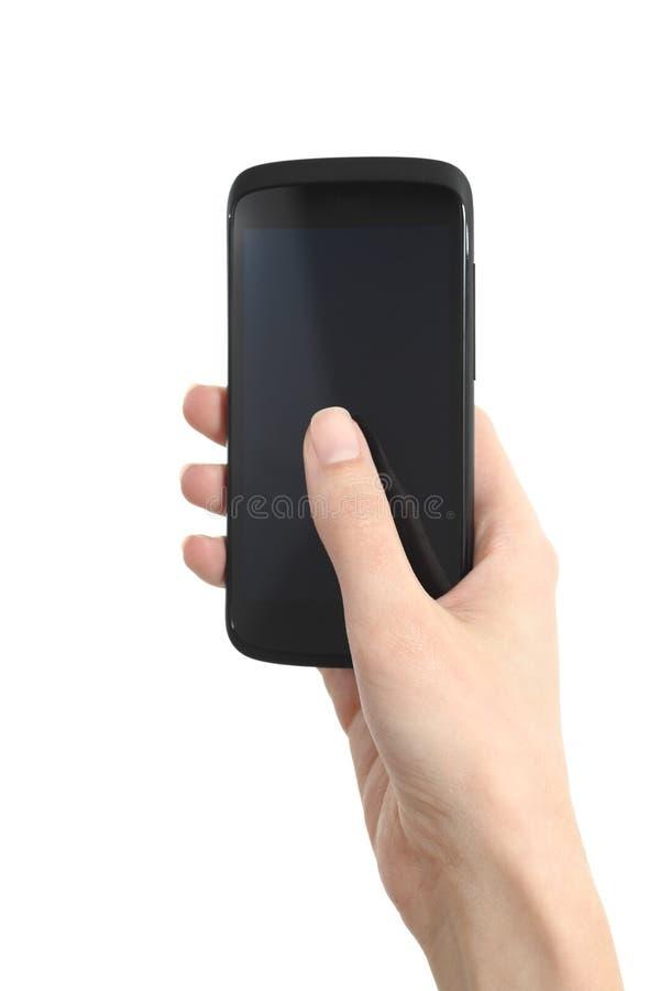 De hand van de vrouw wat betreft het mobiel telefoonscherm met haar duim stock afbeelding