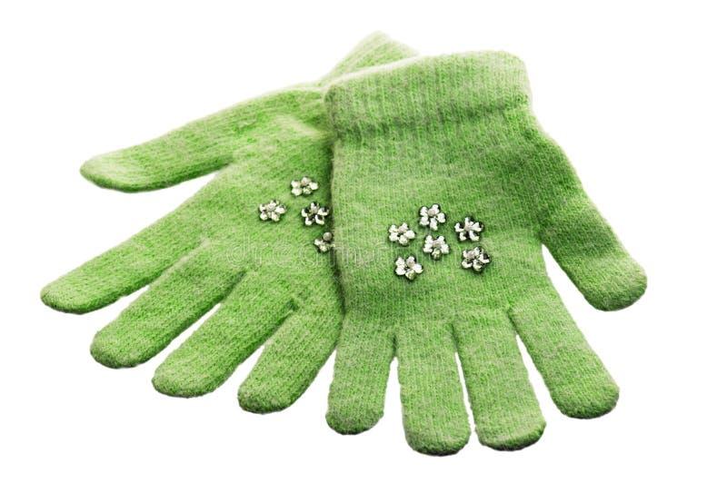 De handschoenen van groene kinderen stock afbeeldingen