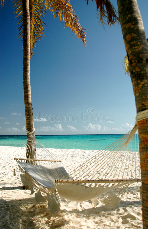De hangmat van het strand stock afbeelding