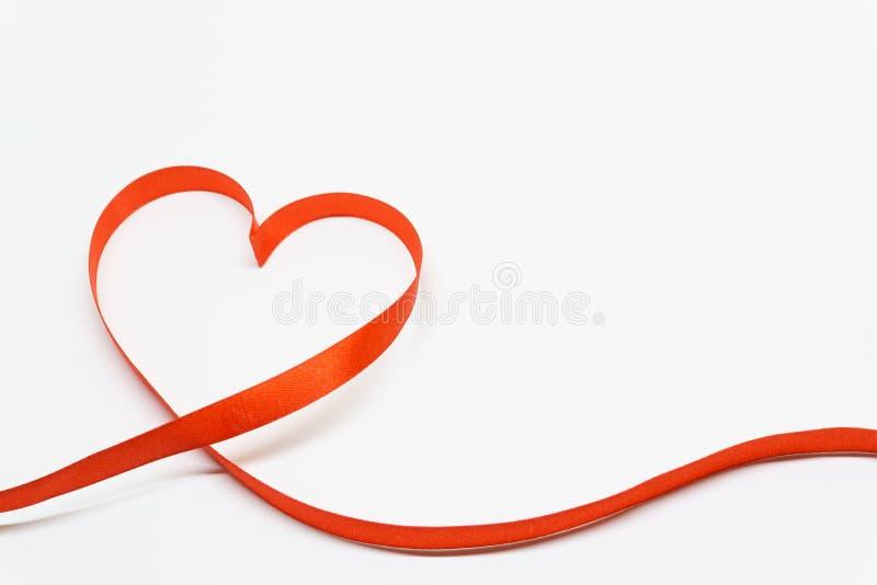 De hart gestalte gegeven Dag van lintvalentine ` s stock afbeeldingen