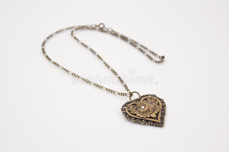 De hart-vormige gouden halsband van de vrouw stock afbeeldingen