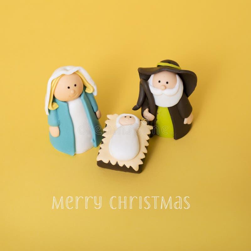 De heilige familie en tekst vrolijke Kerstmis stock afbeelding