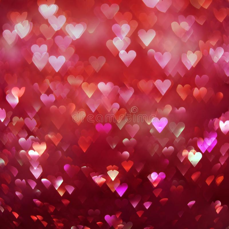 De heldere rode achtergrond van harten abstracte bokeh royalty-vrije stock afbeeldingen