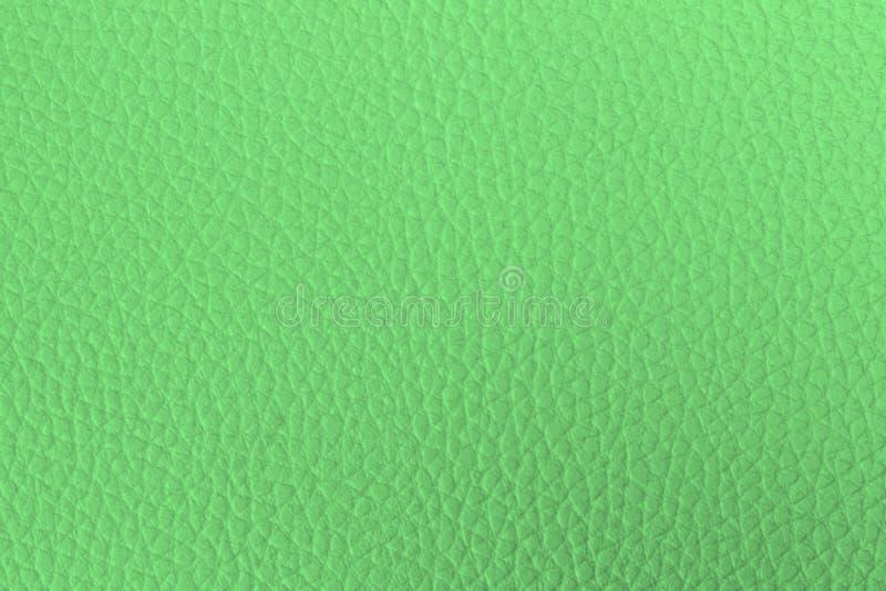 De heldergroene leertextuur wordt gebruikt als achtergrond royalty-vrije stock afbeeldingen