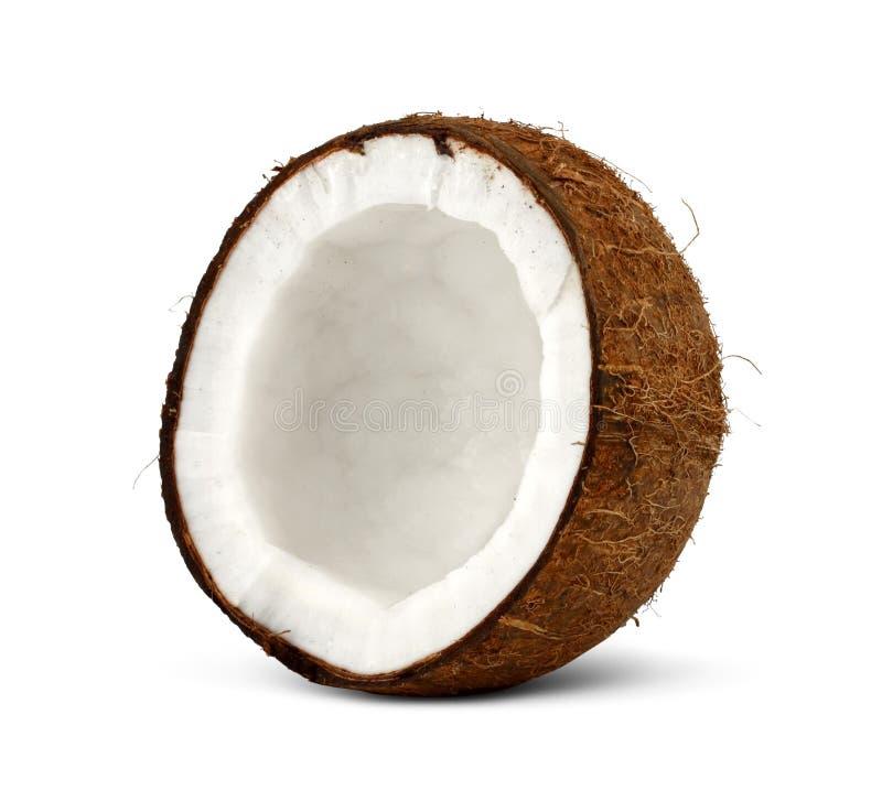 De helft van kokosnoot op wit stock foto's