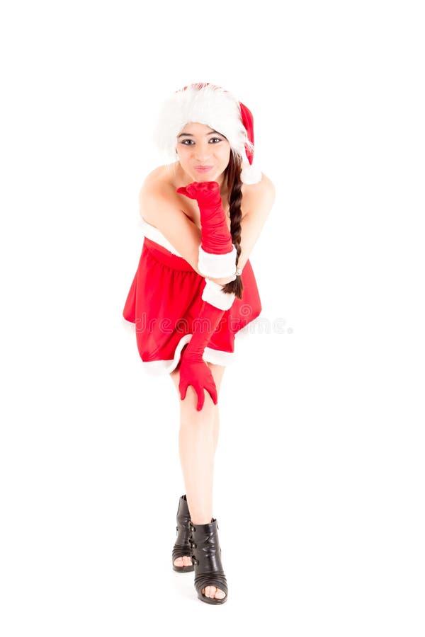 De helpermeisje dat van de kerstman een kus geeft aan u stock foto's