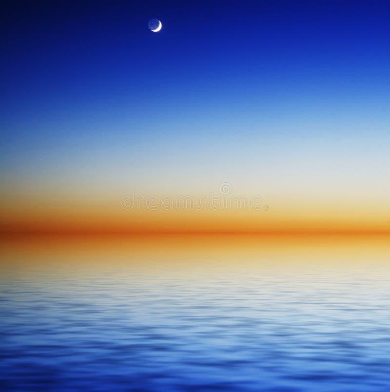 De hemel van de nacht over het overzees stock afbeelding