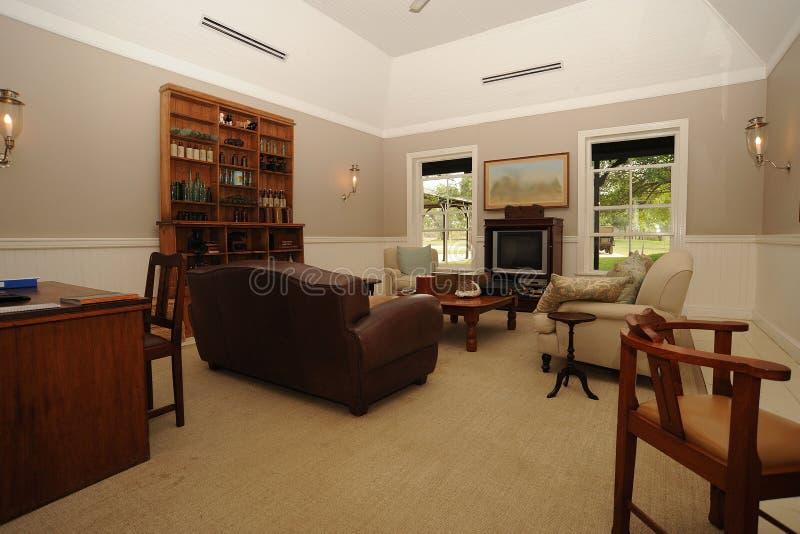 De het gebiedsbinnenkant van de zitkamer brengt onder stock fotografie