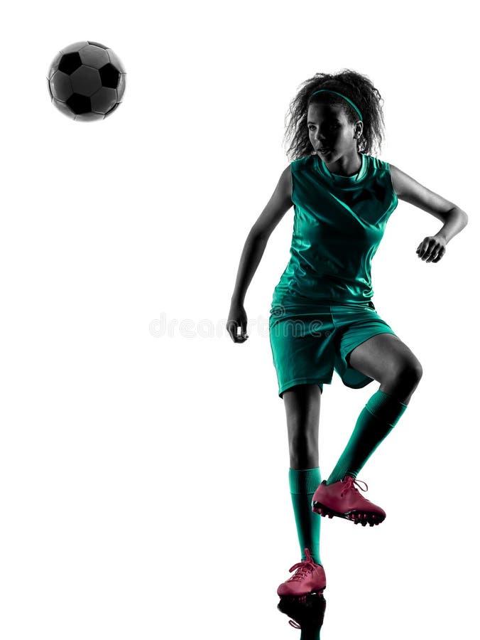 De het kindvoetballer van het tienermeisje isoleerde silhouet stock foto's