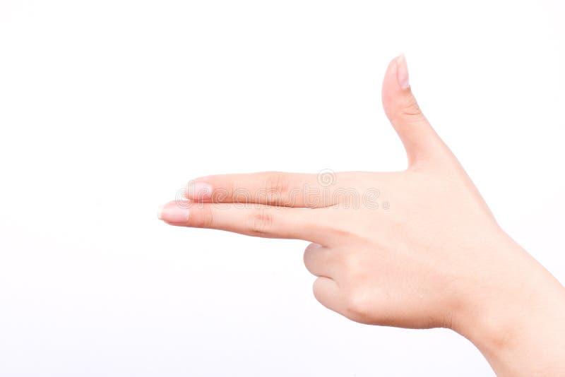 De het meisjessymbolen van de vingerhand isoleerden conceptendoel die de moordenaar van de kanonhand op witte achtergrond richten royalty-vrije stock fotografie