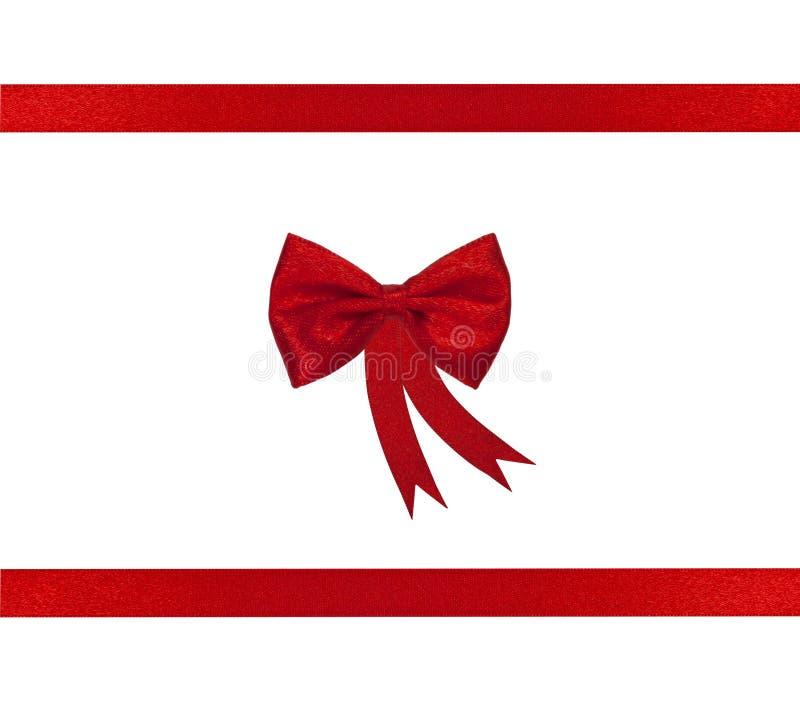 De het rode lint en boog van Kerstmis royalty-vrije stock afbeeldingen