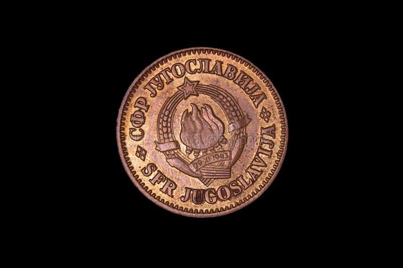 De historische dinar van het numismatiekmuntstuk van Joegoslavië met wapenschild stock fotografie