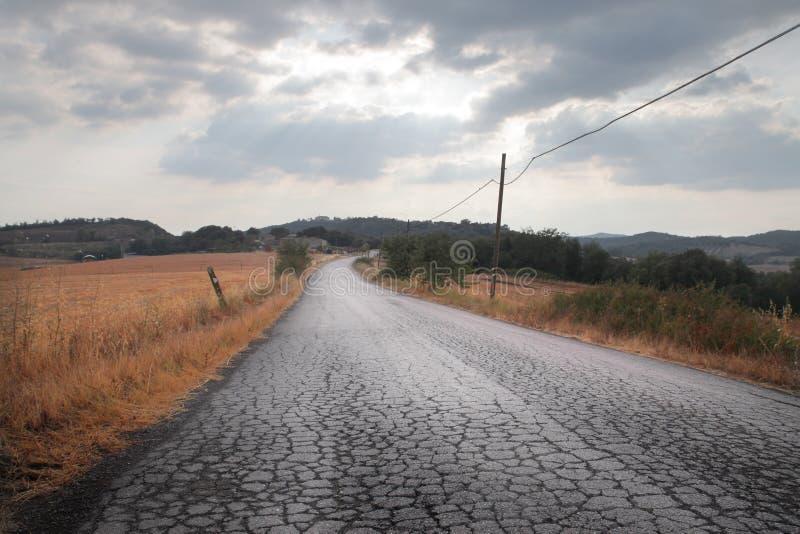 De Hobbelige Weg van het land stock foto's