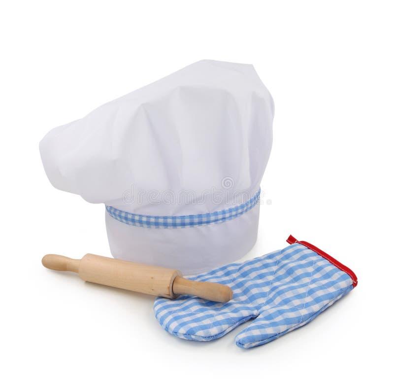 De hoed, de deegrol en de handschoen van de chef-kok royalty-vrije stock fotografie