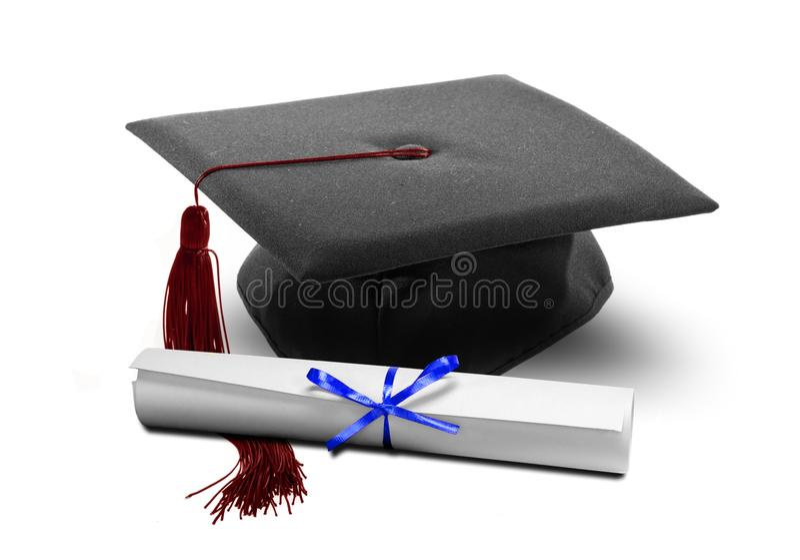 De hoed en het diploma van de graduatie stock fotografie