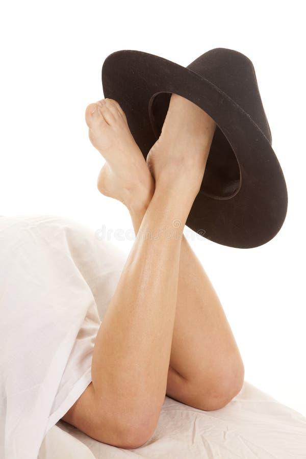 De hoed van de de dekkingscowboy van benen stock afbeelding
