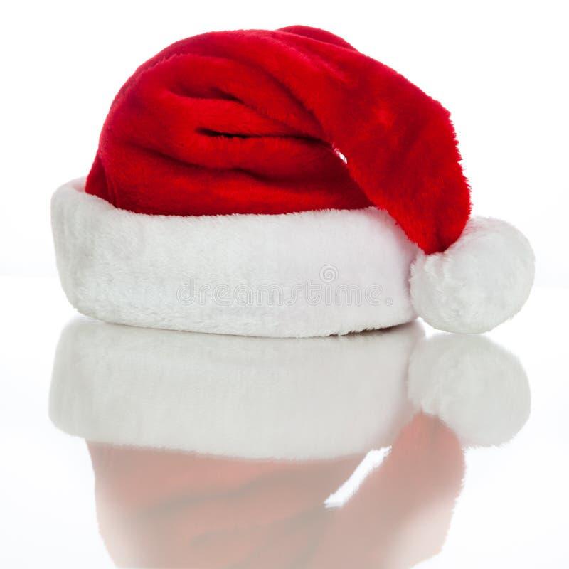 De Hoed van de kerstman met Bezinning stock foto's