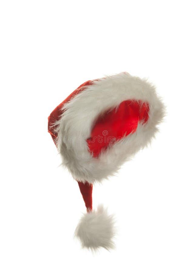 De hoed van de kerstman die op witte achtergrond wordt geïsoleerde stock afbeelding