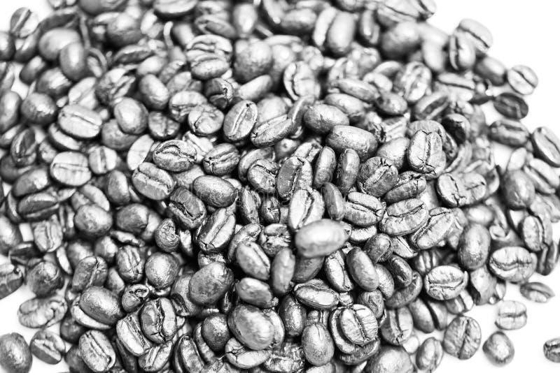 De hoge zeer belangrijke zwarte van koffiebonen met stock afbeelding