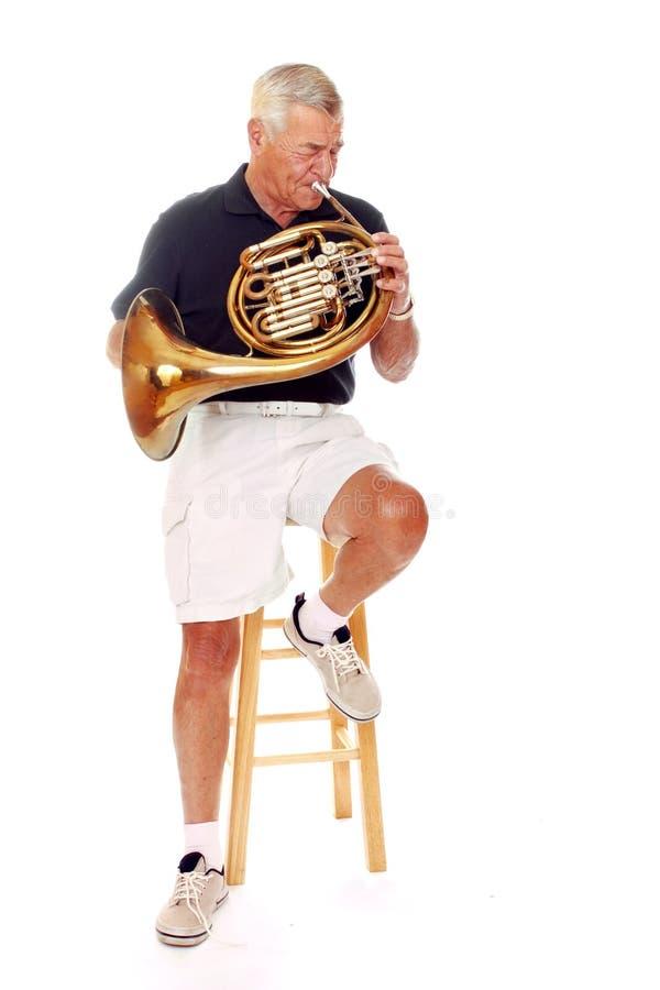De hogere Franse Speler van de Hoorn stock foto's