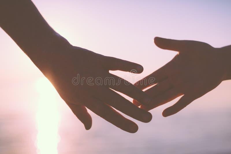 De hogere Handen van de Holding van het Paar stock foto