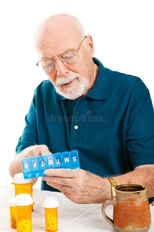 De hogere Sorterende Pillen van de Mens royalty-vrije stock foto