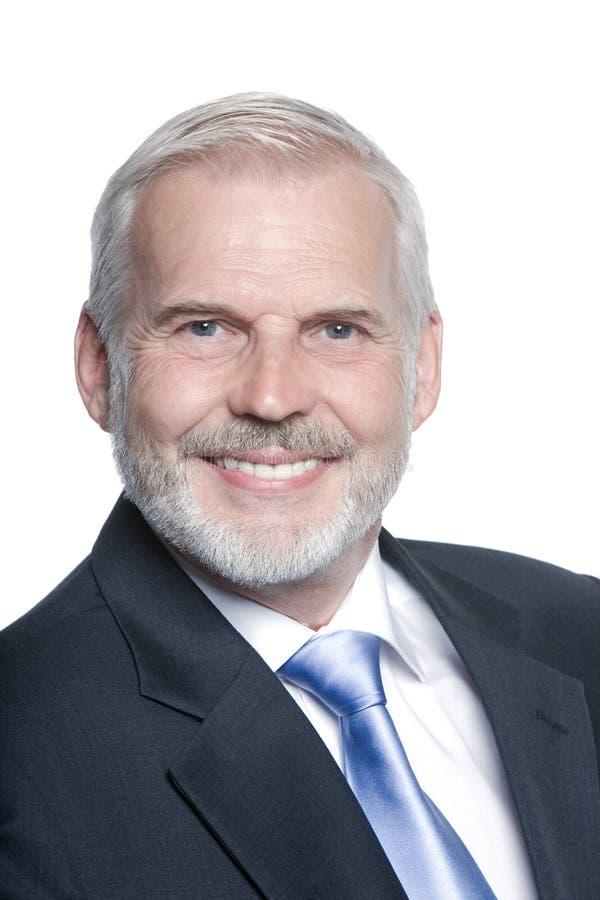 De hogere vriendschappelijke glimlach van het zakenmanportret royalty-vrije stock fotografie