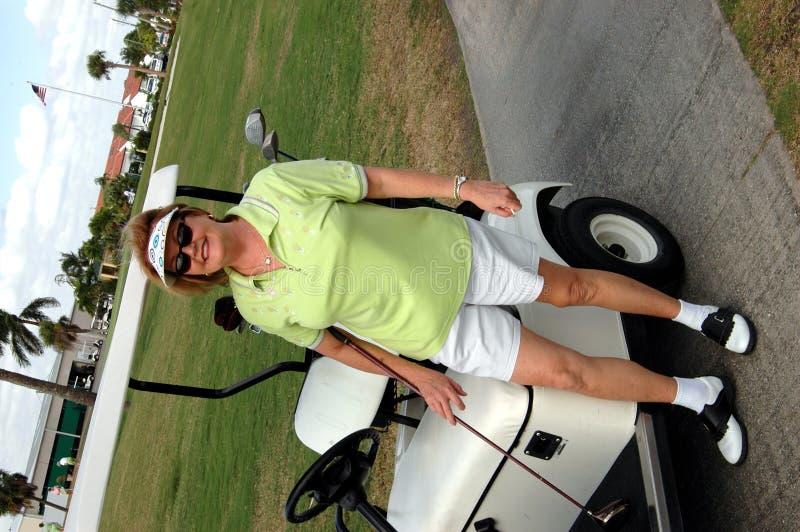 De hogere vrouw van het golf stock foto
