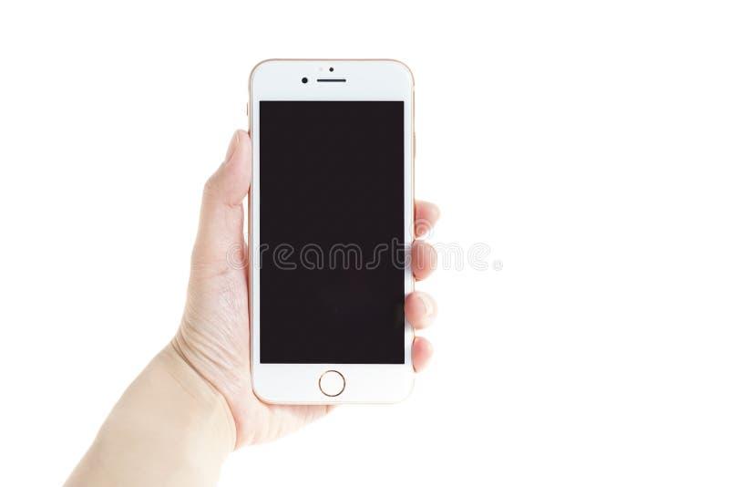 De holding iphone8 van de dame` s hand op witte achtergrond wordt geïsoleerd die royalty-vrije stock fotografie