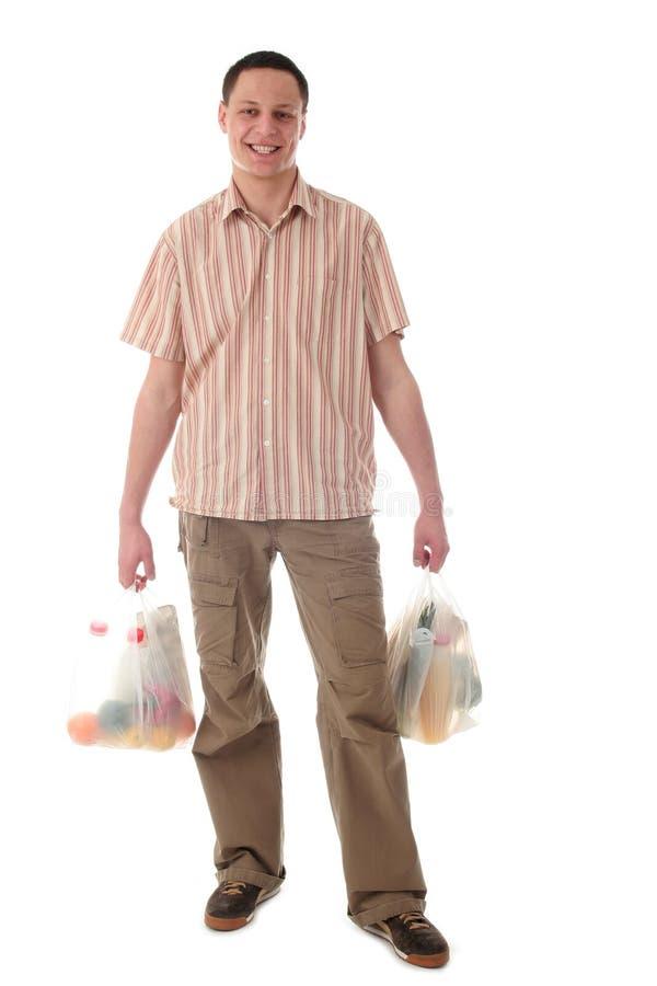 De holding van de mens het winkelen zakken stock fotografie
