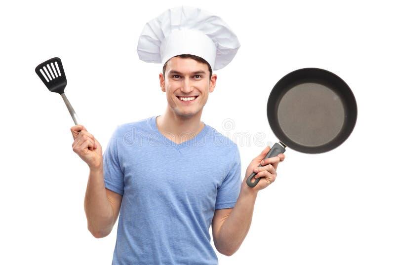 De holdings kokende werktuigen van de chef-kok stock afbeeldingen