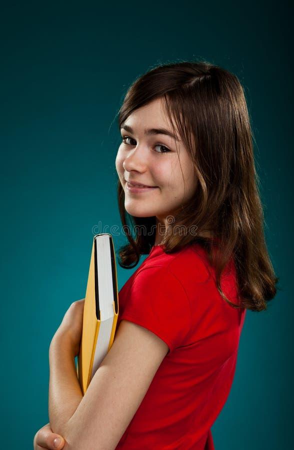 De holdingsboeken van de student royalty-vrije stock afbeelding