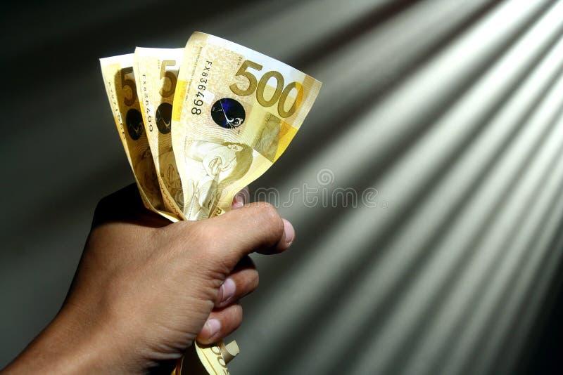 De holdingsgeld van de hand royalty-vrije stock foto