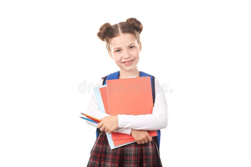 De holdingshandboeken van het schoolmeisje stock fotografie