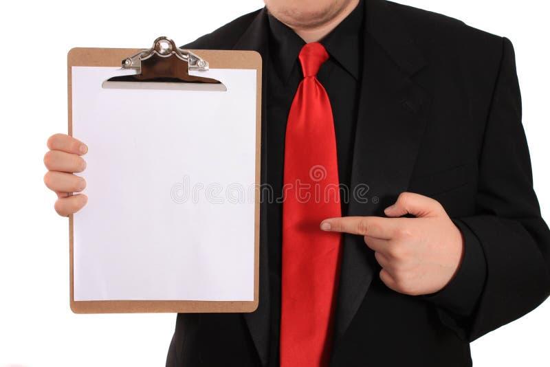 De holdingsKlembord van de mens met blanco pagina royalty-vrije stock foto's