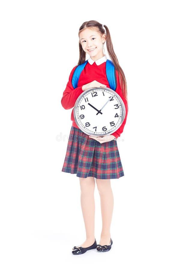 De holdingsklok van het schoolmeisje royalty-vrije stock foto's