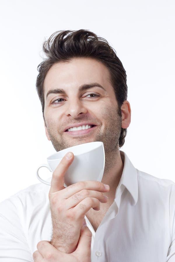 De holdingskop van de mens van koffie stock foto