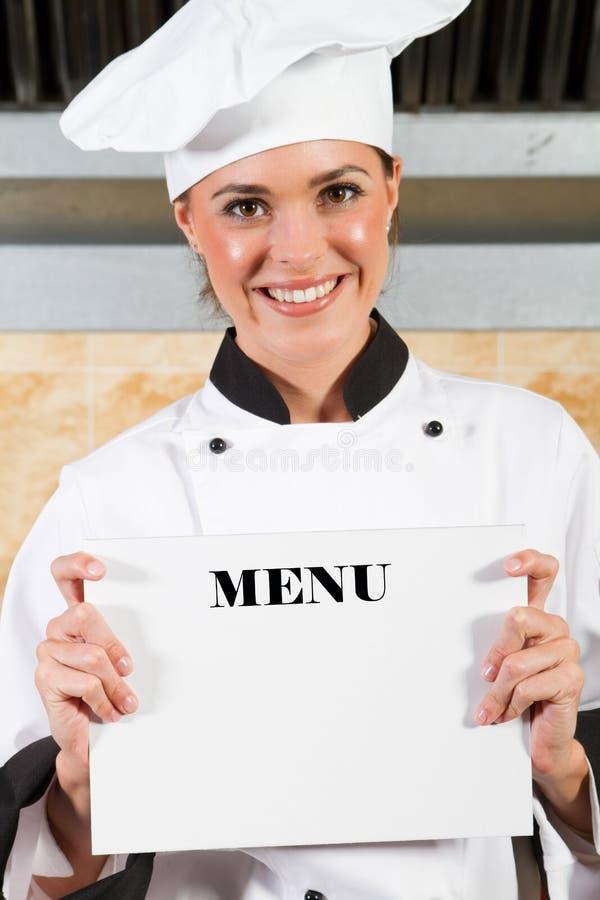 De holdingsmenu van de chef-kok stock afbeelding