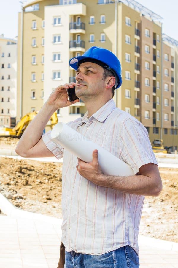De holdingsproject van de bouwmanager stock foto