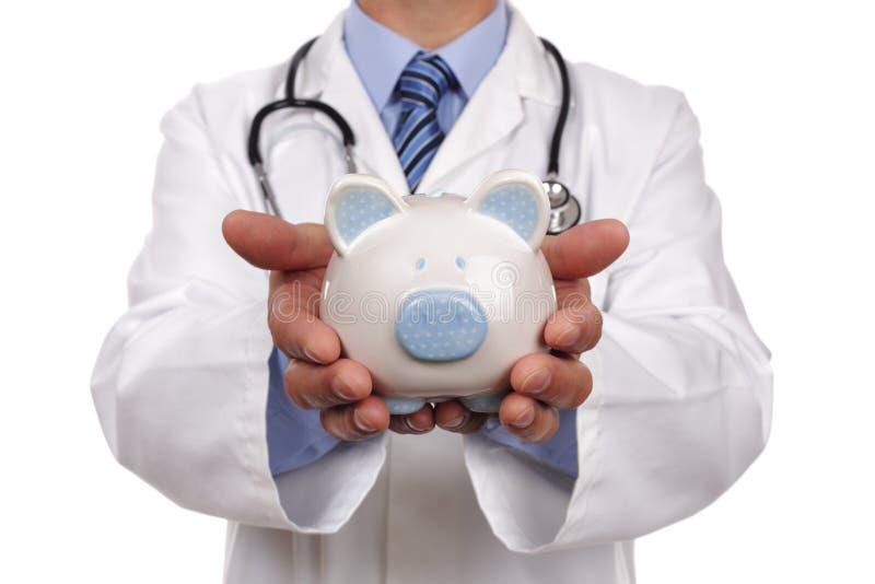 De holdingsspaarvarken van de arts stock afbeelding