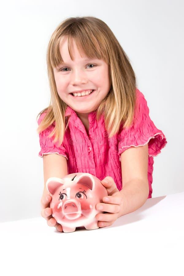 De holdingsspaarvarken van het meisje royalty-vrije stock foto
