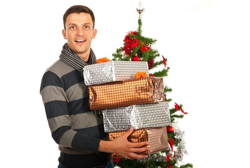 De holdingsstapel van de Kerstmismens giften royalty-vrije stock foto
